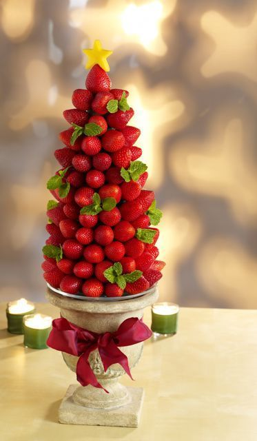 I have to prepare a table centerpiece for a women's holiday event at my church. I'm going to be representing fresh Florida produce with this yummy, edible Christmas tree. Thanks to Sue Harrell of the Florida Strawberry Growers Association for suggesting it!