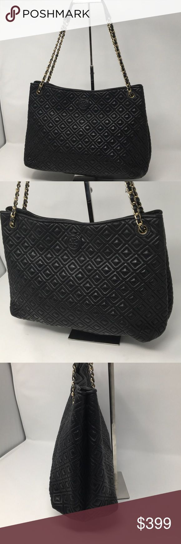 """Tory Burch Marion Diamond Quilted Shoulder Bag Very good condition see last photo slight wear to edging on inside rim of bag. Includes a new non Tory dustbag.  13""""L x 5.5""""H x 9.5""""W  *Black Leather. *Center compartment with magnetic snap. *Interior center zip pocket. *Interior front snap pockets with two open pockets at front. *Interior back zipper pocket. *Drop length when a handle is doubled as shorter shoulder strap: 10"""" *Drop length handle is 22"""" Tory Burch Bags Shoulder Bags"""