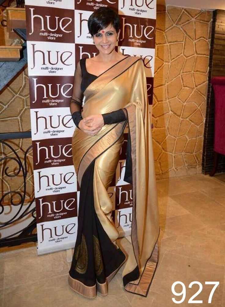 #Mandira #Bedi This satin and chiffon saree is regal in its very colour combination of black and beige. The whole #saree is glamorous and at the same time plain and sober. A very unlikely combination, this unique is a must in every girl's wardrobe. #StayTrendyWithIndiaRush