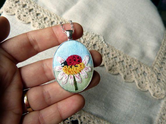 Embroidered pendant ladybug on a daisy botaical necklace