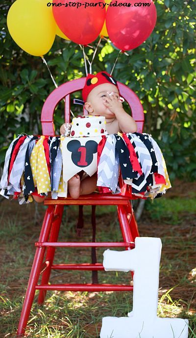 Mickey Mouse themed highchair idea for a 1st birthday.  See more Mickey Mouse birthday and party ideas at www.one-stop-party-ideas.com
