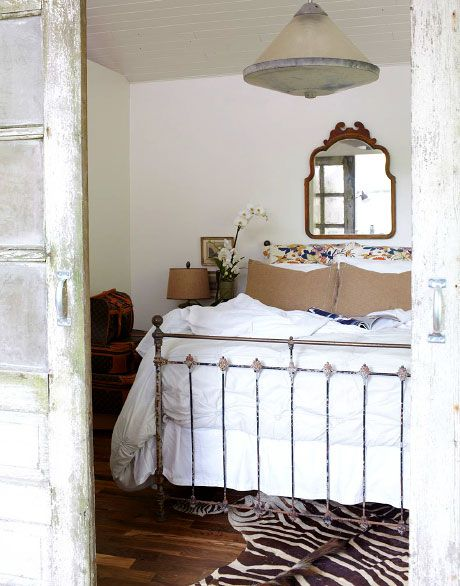 drawn to the rustic feel of this room and the neutral colors.Guest Room, Vintage Mirrors, Beds Head, House Bedrooms, Zebras Rugs, Beds Frames, Antiques Doors, Iron Beds, Carriage House
