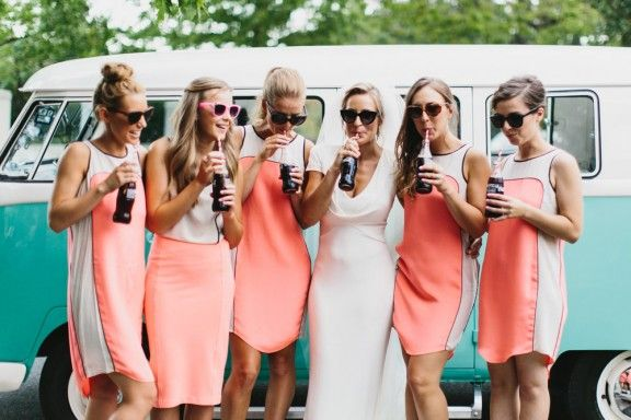 Simple coral and white shift bridesmaid dresses for a vintage inspired wedding.