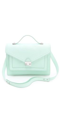 Update your spring look with this pretty pale mint green Loeffler Randall Rider Bag.