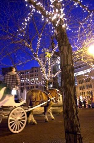Horse and carriage rides are popular this time of year under the Circle of Lights in downtown Indianapolis in 2001.