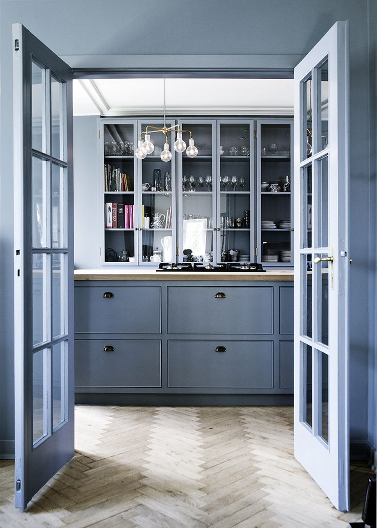 soft denim drift blue kitchen with french doors and glass cabinets