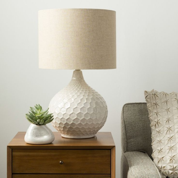 Blakely Cream Table Lamp  Textural accents make any room come alive. Thats exactly what the Blakely Table Lamp achieves with its honeycomb inspired design. The cream ceramic base and beige linen drum shade gives the lamp the neutrality to fit into any room.