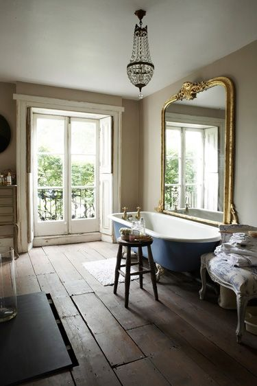 Unfinished decor with classic pieces. Big mirror and patio doors. Lush. Must haves with roll top bath.