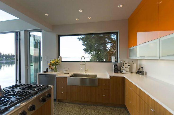 Kitchen countertops in Aurora Snow Hanstone. Interior Design by Creative Spaciz