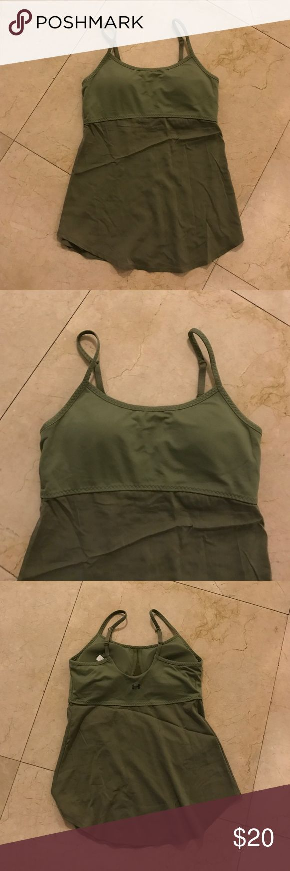 Olive Under Amor Work Out Shirt with Built in Bra Very cute shirt but a bit too long on me. Built in bra with cups and adjustable straps. Bottom half of shirt is not tight as upper bra part. Under Armour Tops Tank Tops