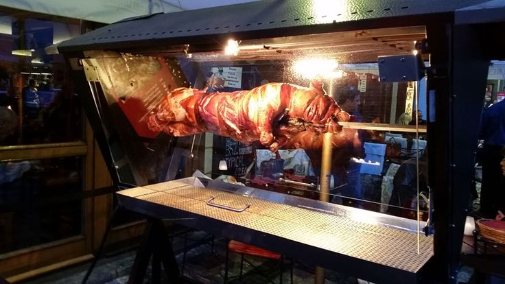 Spit roast is one of the more expensive ways to try Old-style pork in Prague. Restaurants put the roasters outside 1) as an attraction, 2) because it saves space and 3) because it smells great.
