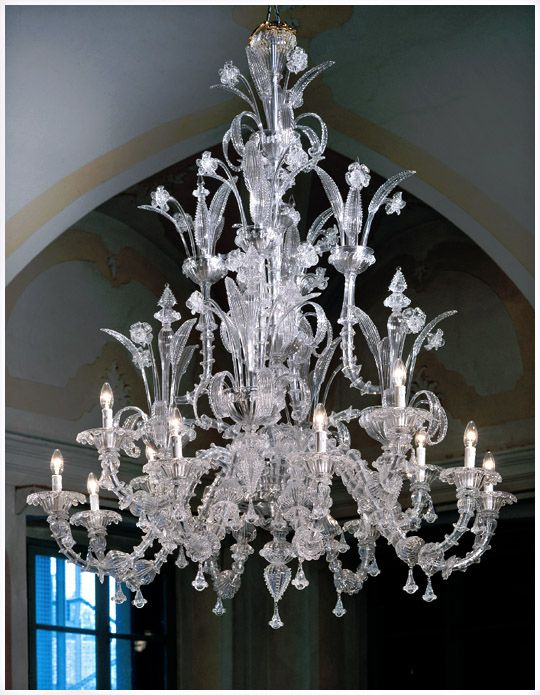 "Murano Ca Rezzonico 7061K8+4 style chandeliers in clear glass with gold details, milk white with gold leaf color or completely in clear glass.  There is a handcrafted traditional Venetian Murano chandelier, lighting fixture and extraordinary Murano glass artwork as one completed by genuine Murano master. Murano glass chandelier lighting fixture with 12 light arms. Dimensions: Ø 55.2"" (140cm) X h 65"" (165cm) Bulbs: 12 x 40W or 60W – 110v E12 bulbs"