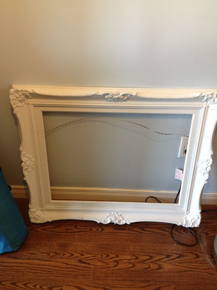 Old frame sanded, primed and painted white.