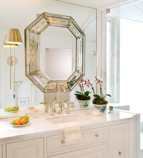 My favorite trend now is mounting your light fixture onto a huge mirror in the bathroom. Mirrors make small spaces appear larger than what they are....and then mounting a vintage venetian mirror ontop of the large mirror is super chic.