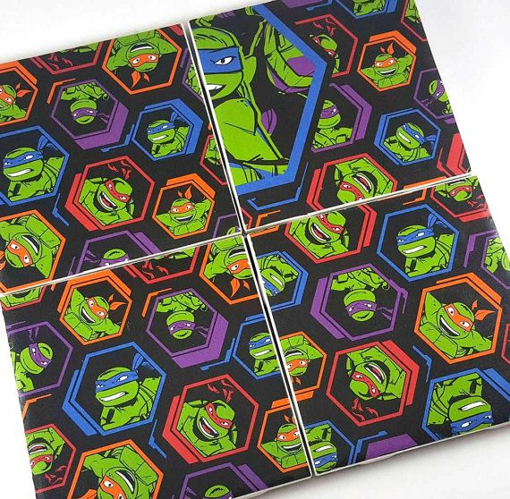 These adorable TMNT coasters are the perfect gift for any nerd/geek in your life who loves to show off their geek, especially in their house.  All coasters measure 4.25 x 4.25. All coasters are made using quality tiles, covered with quality paper, and sealed with a water resistant sealer. They also are lined with felt to prevent the tile from scratching the surface of your furniture. The coasters ARE water resistant, but are not designed to be washed or put in the dishwasher. It's advise...