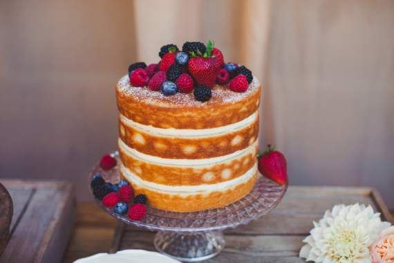 Naked Wedding Cakes   This cake has strawberries and blueberries, which add color and texture to this natural cake.  This type of cake is ideal in the summer when fresh fruit is in season.