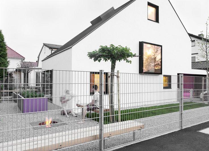 Asymmetrical Pitched Roof Defining Minimalist Family Home near Munich - http://freshome.com/assymmetrical-pitched-roof-defining-minimalist-family-home-near-munich