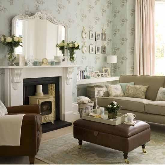 Modern vintage living room log burner and brown sofa with plae decore