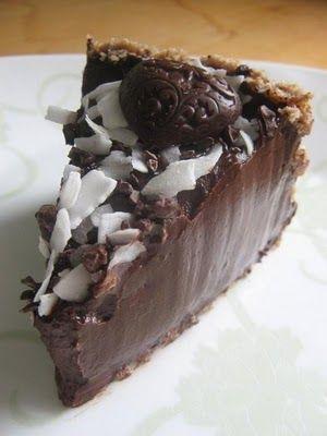 CHOCOLATE-BANANA PUDDING CAKE {4 avocados, 1 banana, cocoa powder, agave, maple syrup, coconut oil, vanilla bean, pecans, dates, coconut flakes, chocolate chips}