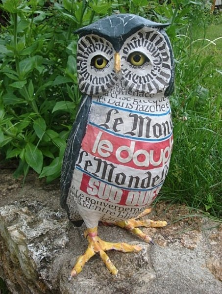 Wise owl; use papier mache and newspaper to make this papier mache sculpture.