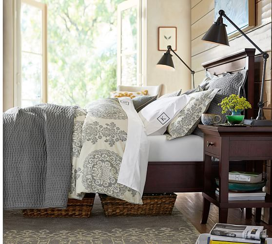 Room has black & brass accents, and painting above bed has teal :)   Lucianna Medallion Duvet Cover & Sham | Pottery Barn