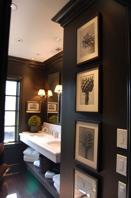 home / interior design / bathroom with dark painted walls. floating vanity. sconces. natural light. black and white art. Love
