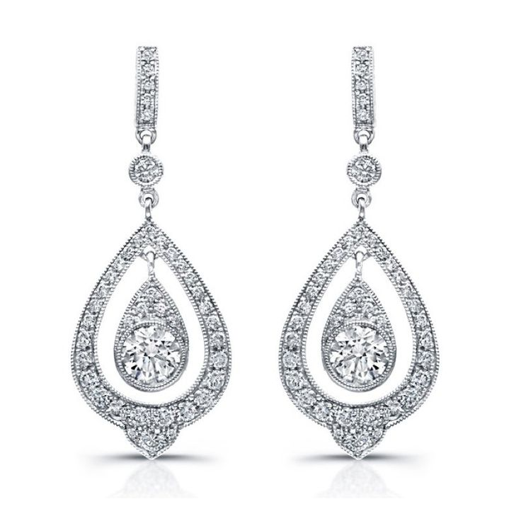 With luxurious beauty, these regal 18k white gold cross earrings feature a center teardrop with a round diamond surrounded by a teardrop shaped boarder encrusted with pavé diamonds. They are available in 18k white, rose and yellow gold, as well as platinum.