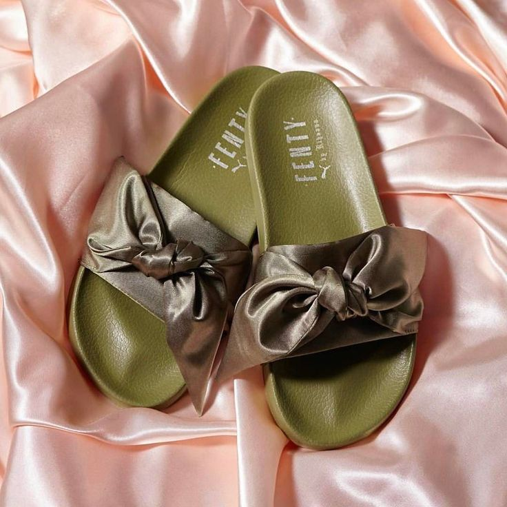 #FentyxPuma shoes have a history of selling outand boy do they sell out quickly. Last April @BadGalRiRi $80 furry Puma slides sold out in a matter of hours. Judging from the last drop I suspect the satin bow-tied pool slides in a military-inspired shade of greenwont be much different. The sandals hit on springs overtly feminine mood pretty perfectly and @ $89.95 they're affordable too! The sandals along with the Bow Sneaker from the singer's spring 2017 collection will launch for preorder…