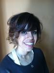Asymmetrical with bangs and a little wave by Laura at Posh the Salon.