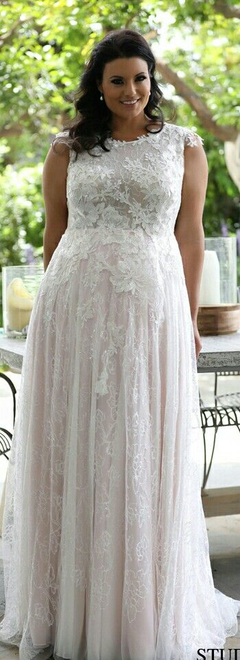 Plus size blush lace wedding gown with a high neck. Full of sparkles and flowers. Daisy. Studio Levana