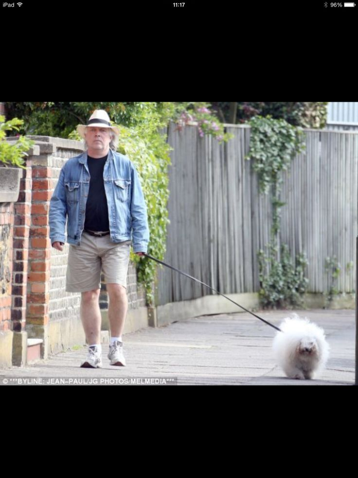 Rik Mayall with his a Bolognese dog