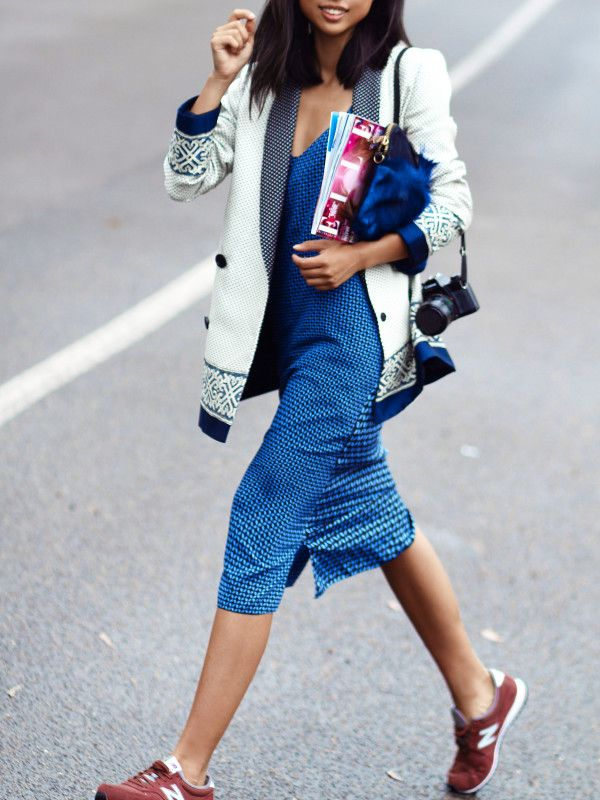 Margaret Zhang showing us how to rock the sneakers and dress combo. Take notes.