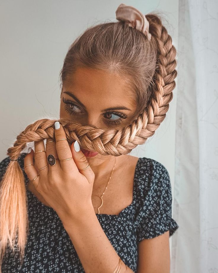 neat fishtail braided hairstyle