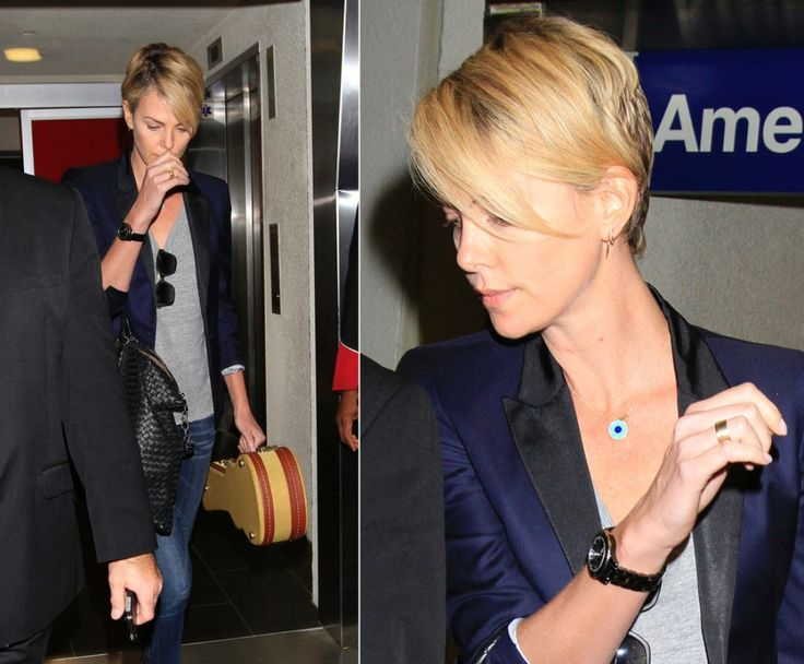 Charlize Theron arrives home in Los Angeles after a vacation in Hawaii on Jan. 1, 2014. Rumors of a romance between Theron and Sean Penn arose after the couple was spotted together on the Hawaiian beaches.