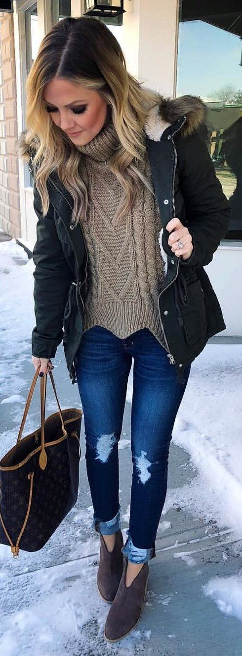 #winter #outfits black parka coat, brown cable-knit sweater, and distressed blue denim jeans outfit. Pic by @thestyledduo.