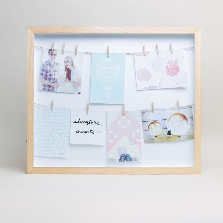 Umbra International Clothesline Picture Frame: Glass fronted shadow box wooden picture frame from Umbra International. A fun way to display family photos, or old tickets and other precious memorabilia.