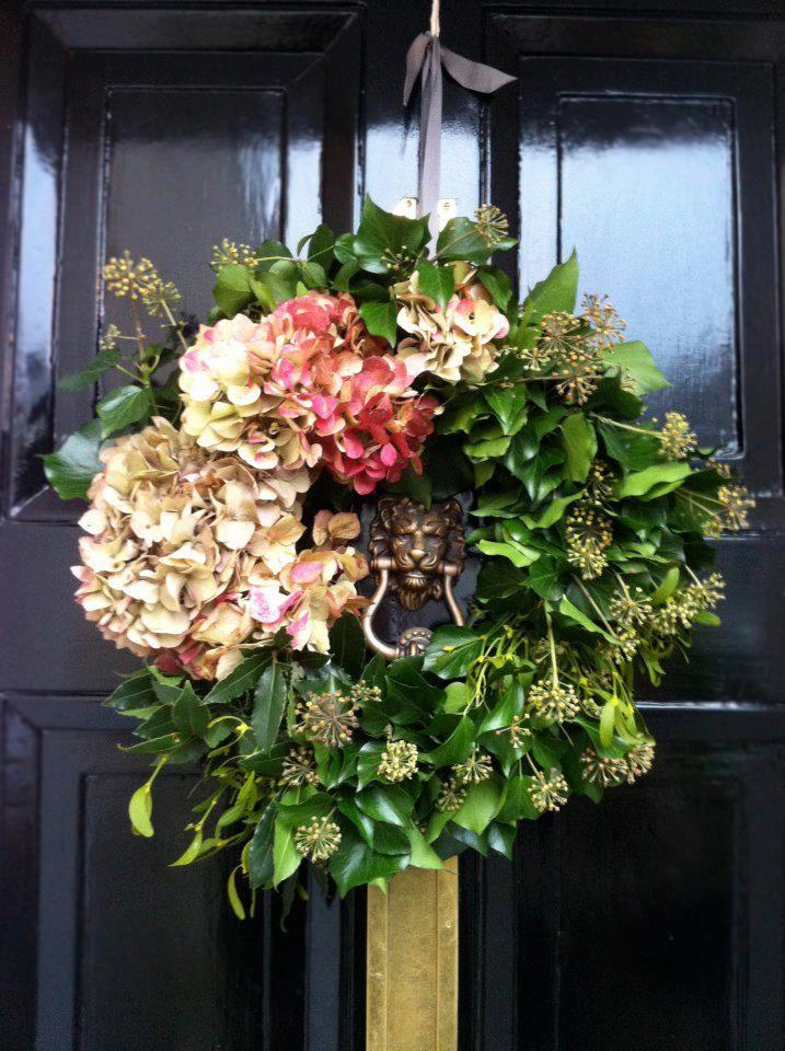 A Mistletoe, Hydrangea and Ivy festive wreath over a Farrow & Ball, Pitch Black Full Gloss door.