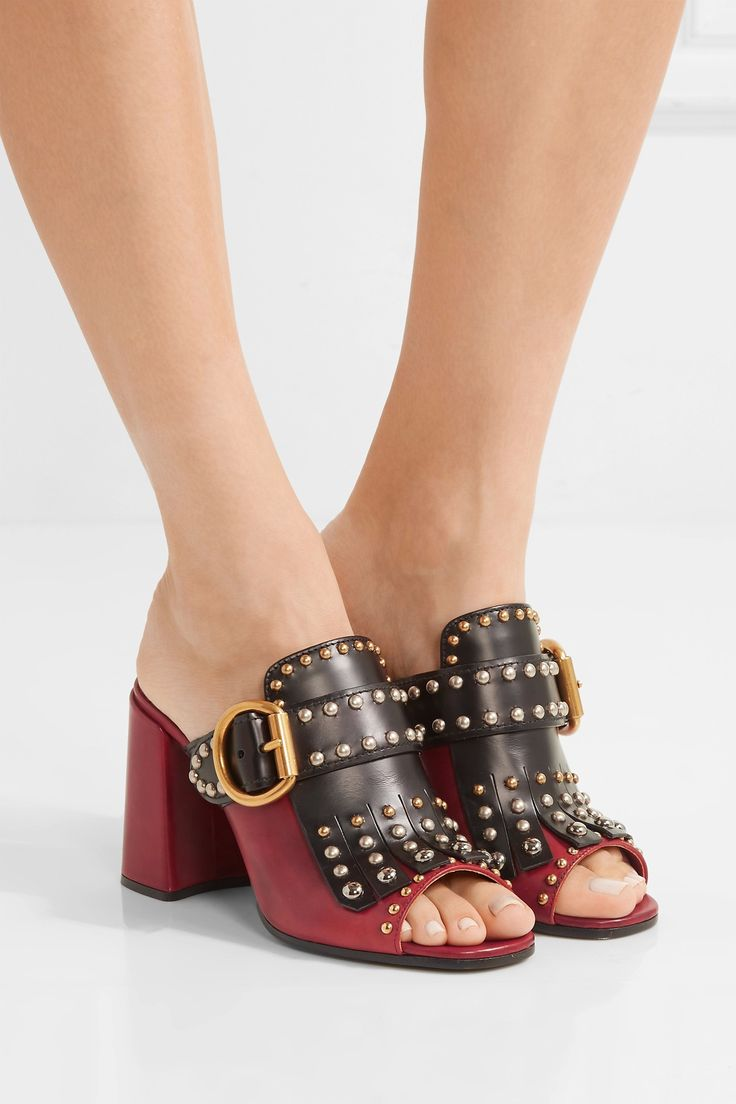 PRADA Fringed studded leather mules  $995.84 https://www.net-a-porter.com/product/743745