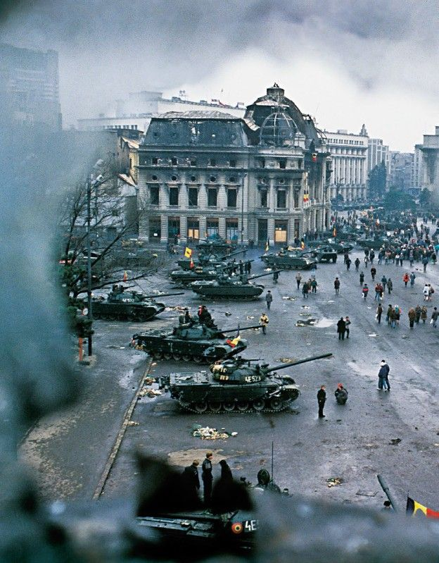 A view of tanks of damage done in Bucharest's central square at the conclusion of the Romanian Revolution, following Ceaușescu's execution. December 1989.