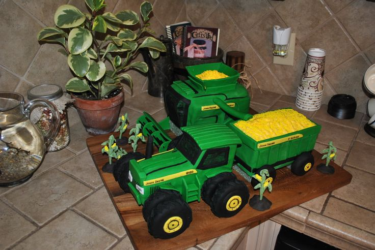 John Deere Tractor and Combine Harvesting - This was a birthday cake for my son's 3rd birthday.  He is in love with John Deere tractors, and I promised him I was going to make him a John Deere tractor and combine harvesting as his cake.  After some wonderful advice from some of you here on Cake Central, I was able to really nail the fondant draping this time (still a few bad spots) but overall this cake is the cleanest and smoothest cake I've ever done (so THANKS to all of you who gave me…
