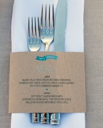 DIY menus printed on kraft paper were used to hold together the napkin and silverware at each place setting