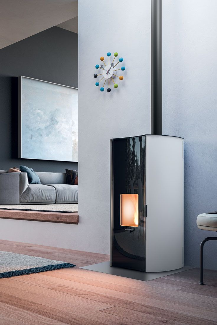 ECOFIRE® BEATRICE | A sealed, air-heating pellet stove with an original rounded shape and a concave glass door. Available in black or white, with optional base  --- Stufa a pellet di design ermetica e ad aria dalla particolare forma stondata, con porta in vetro concava. È disponibile in bianco o nero e con piedistallo opzionale.