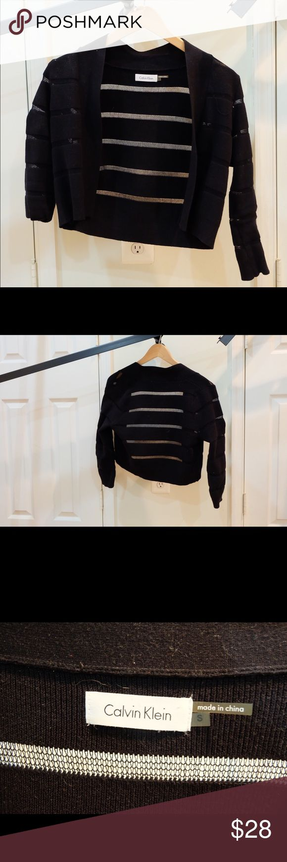 Black Calvin Klein Short Cardigan Feminine yet bold, this cardigan is cropped and polished with a pencil skirt or high waisted work pants. The transparent stripes make arms look amazing and elegant. 78% cotton and 22% nylon. Calvin Klein Sweaters Cardigans