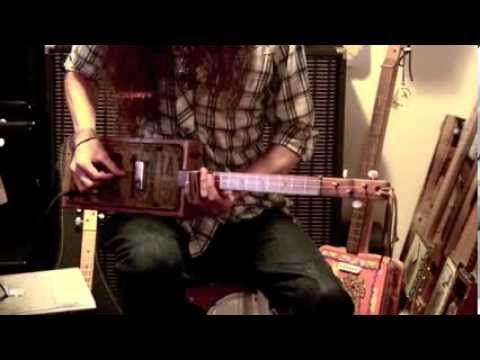 """Justin Johnson teaches a lesson on how to play """"Walkin' Blues"""" on the 3-String Cigar Box Guitar. The guitar is is a 3-string License Plate Resonator by MadDo..."""