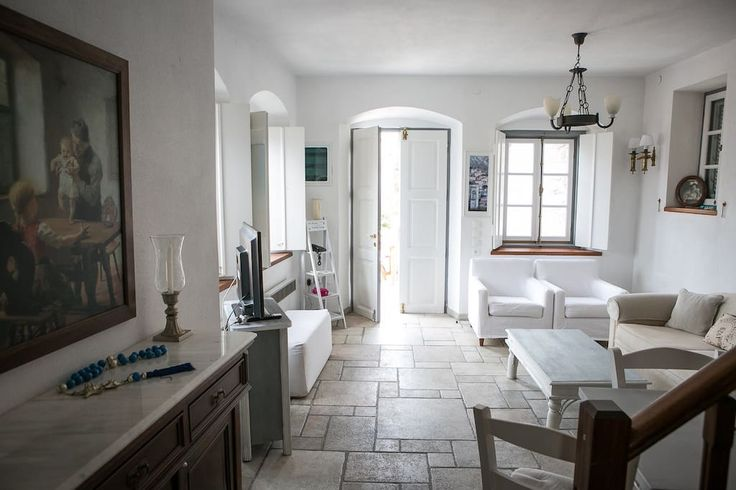 Villa in Hydra, Greece. The Maisonette  is only 250 meters from the port of Hydra on a main, level road with no street steps to climb (other than the 20 shallow steps to the courtyard entrance)  The maisonette is  full of double windows to allow the perfect view .   Priv...