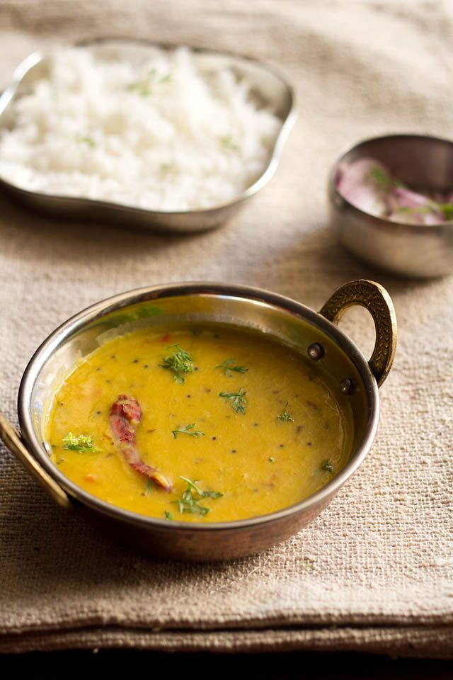 dal fry - a popular lentil based dish made with arhar dal or pigeon pea lentils. this recipe is restaurant style and makes a complete, satisfying meal with some steamed basmati rice or with naan or rotis, accompanied with a side indian salad, raita, pickle, papad or a side veggie dish.   #lentils #indianfood #vegan #lentilrecipes #dal #proteinfoods