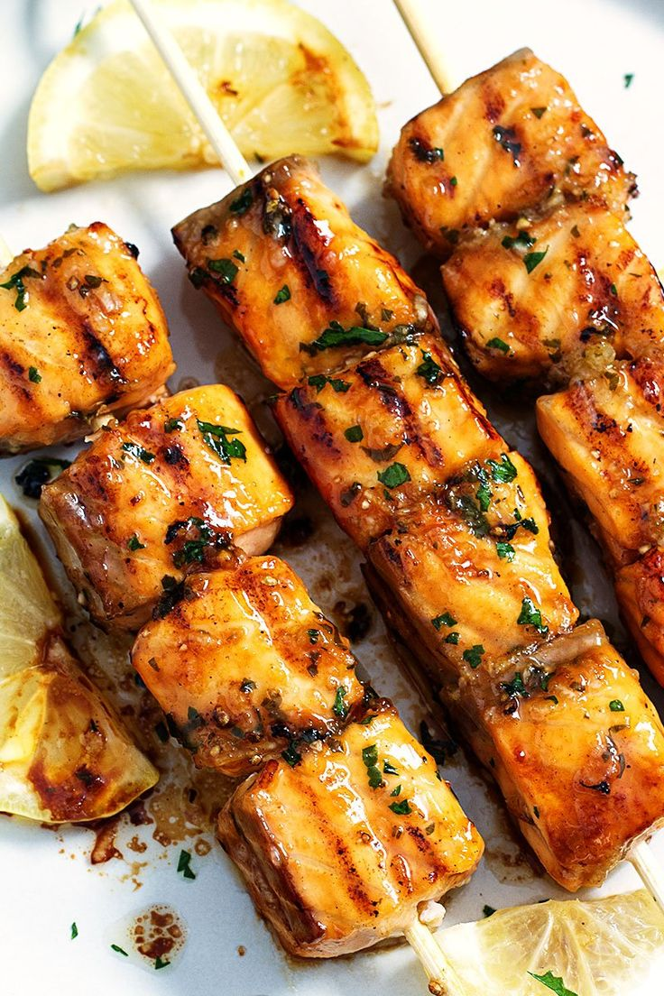 This Lemon Garlic Butter grilled salmon recipe is healthy and so fun to make! From Eatwell101.com
