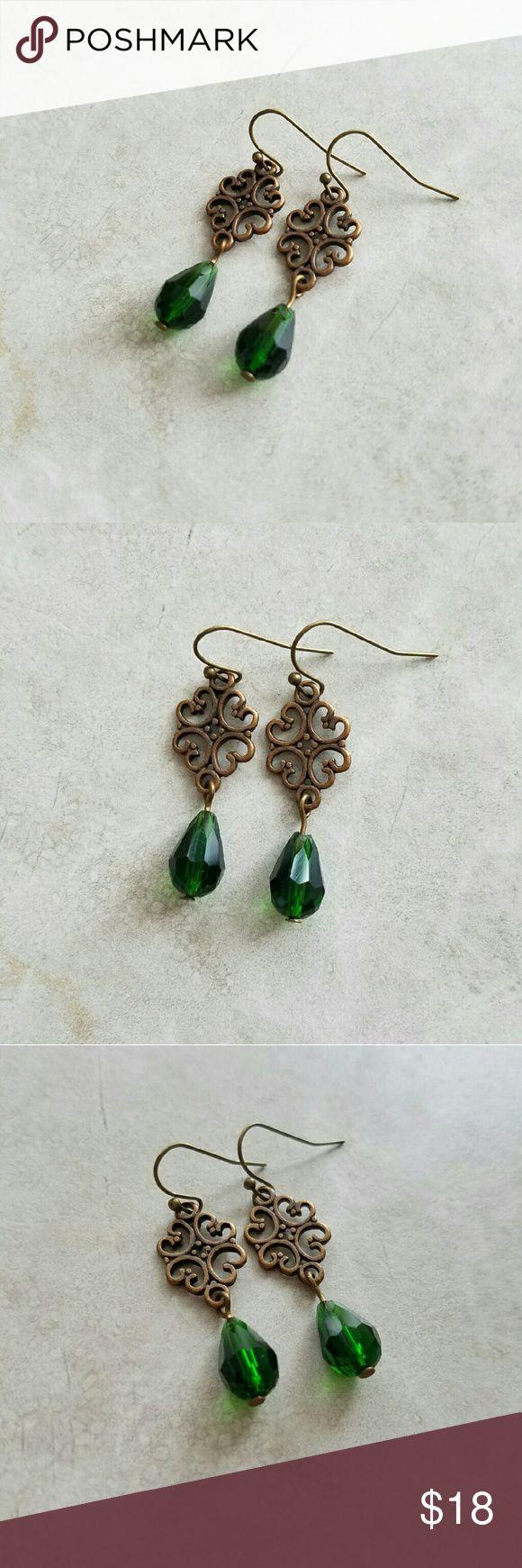 Emerald Green Earrings Lovely, classy earrings.  Green glass teardrops hang from antiqued copper filigree charms.  Brand new, never been worn. Anthropologie Jewelry Earrings