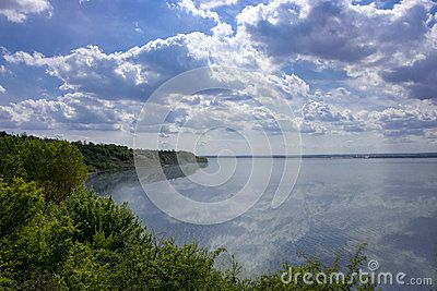 Sunny blue sky with white clouds in sunny spring day