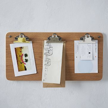 Cool idea. Just buy a few clipboards and line them up on the wall. Similar look to this, costs less than $10.